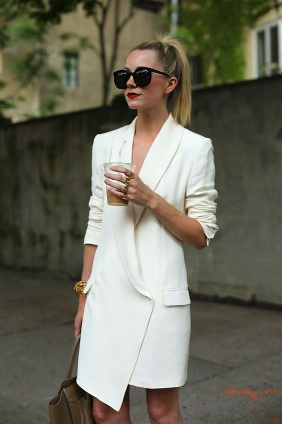 neutral-looking office outfit with a creamy blazer dress with a V-neckline and a red lip to look wow
