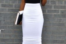 show off your legs without showing off too much skin – wear a white midi pencil skirt, a black sleeveless top, nude strappy shoes and white statement earrings