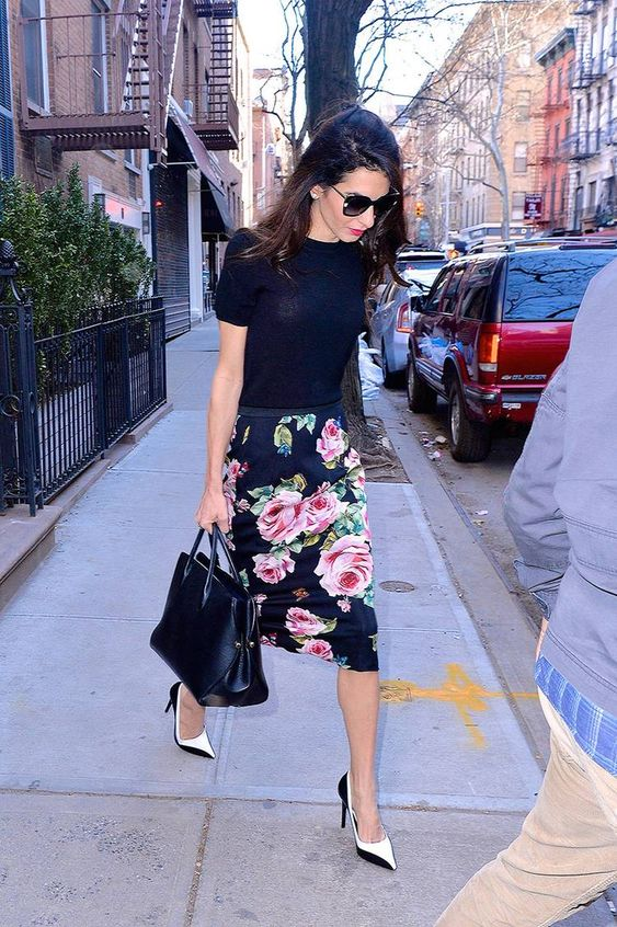 a black tee a dark floral pencil skirt, two tone shoes and a black tote for a cool spring work look