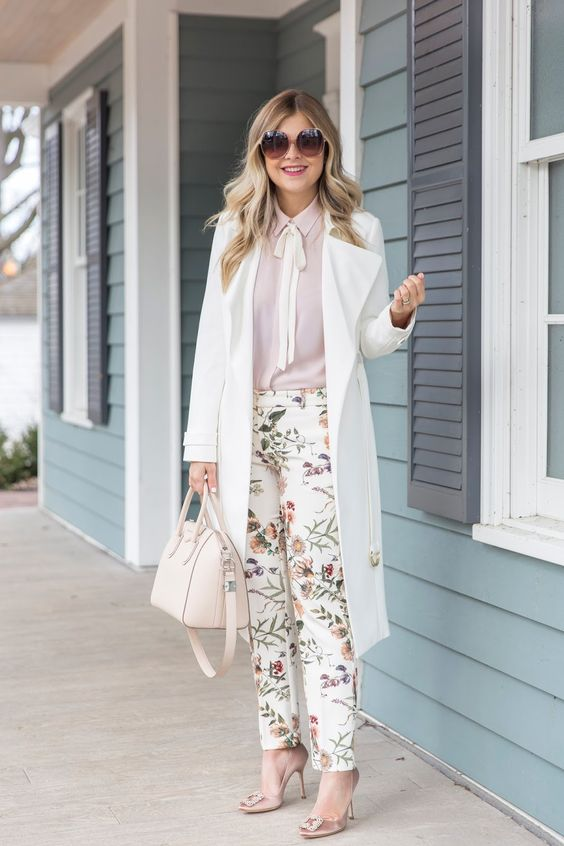 a blush shirt, floral pants, blush shoes, a white trench and a white bag to rock in spring or summer