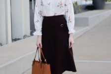 a fall work outfit with a floral blouse, a black A-line midi, nude shoes and a rust-colored bag