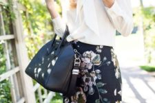 a monochromatic look with a white bow blouse, a dark floral knee skirt and a black bag
