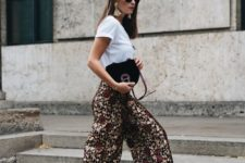 a statement summer work look with a white tee, dark floral culottes, gold shoes and statement earrings