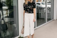 a summer work look with a dark floral top, white wideleg pants, nude lace up shoes and a tan bag