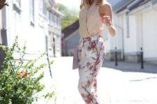 a summer work look with a sleeveless neutral top, white and pink floral pants, creamy shoes and a clutch