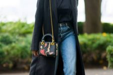a black trench, black heels, a turtleneck and blue straight jeans for a wow spring look