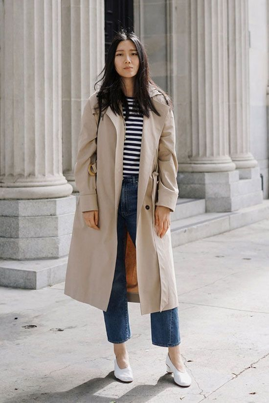 a neutral trench with bold buttons and large pockets in the 90s style is very edgy