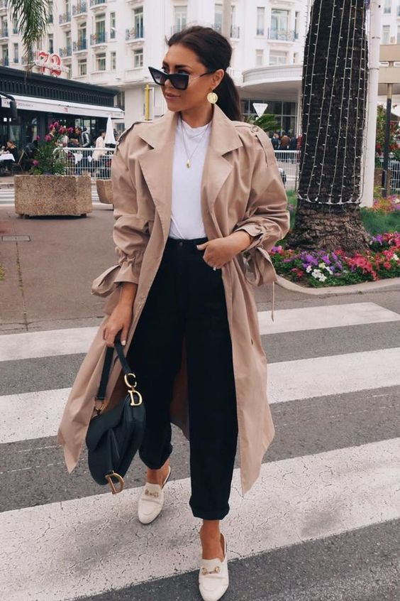 an oversized blush midi trench styled by the 90s is a hot trendy piece to wear this spring