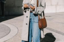 an oversized grey midi trench, flare jeans, black boots and a brown bag for a retro feel in your look