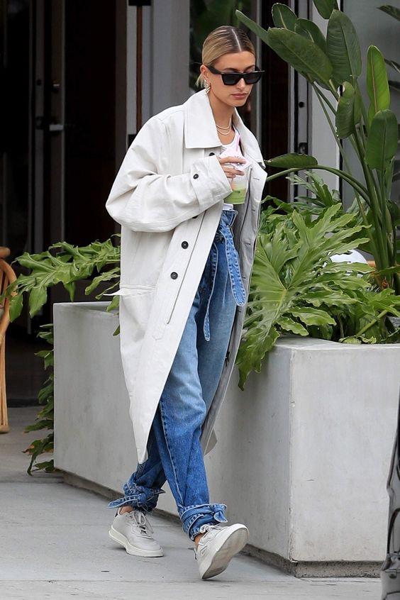 an oversized off-white double-breasted trench with black buttons by Hailey Baldwin