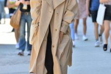 an oversized tan midi trench with pockets can be refreshed with trainers or sneakers for a trendy touch