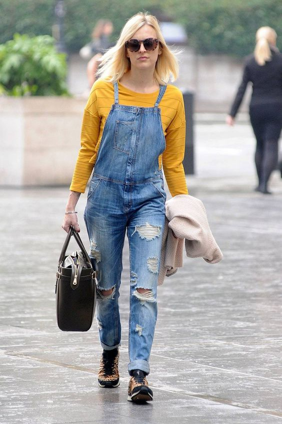 a marigold top, a blue ripped denim dungaree, leopard shoes and a brown bag for a trendy spring outfit