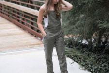 a summer look with a white sleeveless top, nude shoes and an olvie green dungaree is effortless and chic