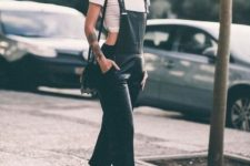a white crop top, a black dungaree, black boots and a black bag for a grunge outfit