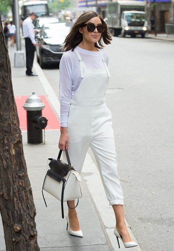 a white sheer top, a white dungaree, white shoes and a two tone bag for a bold summer outfit
