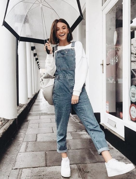 a white sweatshirt, a blue denim dungaree, white sneakers, a white bag for this spring