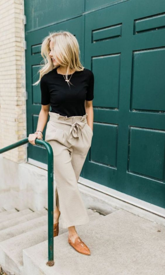 a black tee, tan paperbag pants, brown leather mules for a comfy summer work look