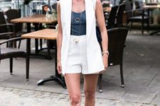a chic summer work look with a white waistcoat and shorts, a graphite grey top, tan shoes and layered necklaces