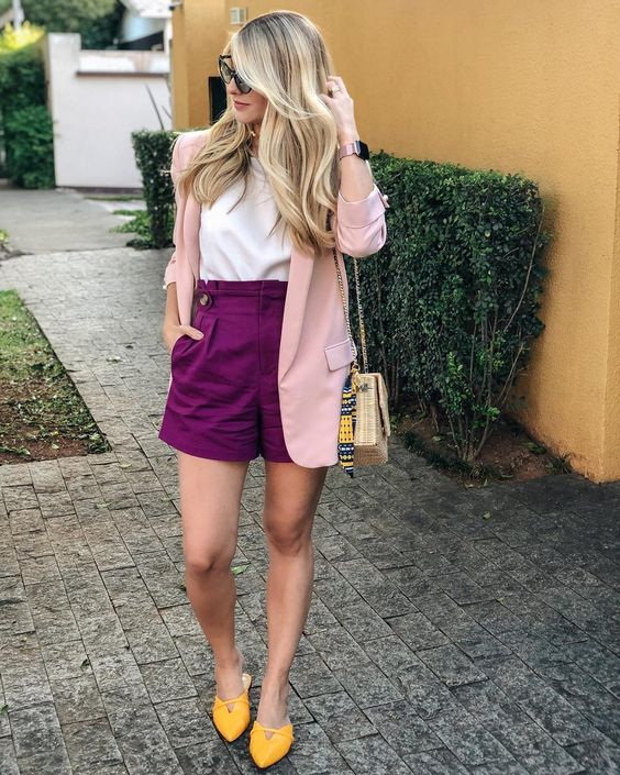 a color block look with a white top, purple shorts, a blush pink blazer, yellow mules and a wicker box bag