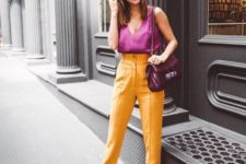 a hot pink sleeveless top with a V-neckline, yellow pants, white shoes and a purple bag for a splash of color