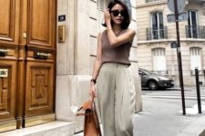 a taupe sleeveless top, olive green pants, brown kitten heels and a brown bag for a hot summer day