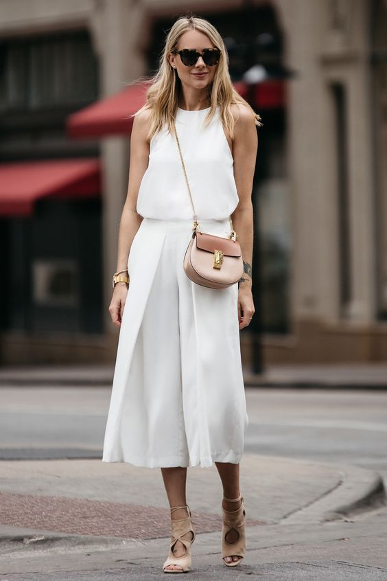 a white minimalist look with a sleeveless top, culottes, tan lace up shoes and a two tone bag