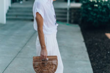 a white oversized shirt, creamy palazzo pants, statement earrings and a wooden semi-circle bag