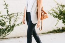 a white tee, black chinoes, a striped long waistcoat, tan shoes and an amber bag