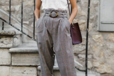 a white tee, oversized paperbag waist pants, black shoes and a purple bag for summer