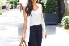 a white top, a white sleeveless blazer, navy cropped pants, tan shoes and an amber bag for summer