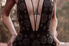 a black celestial embellished one piece swimsuit with a plunging neckline highlighted with laces