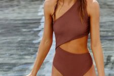 a burgundy one-piece one shoulder swimsuit with a front and side cutout is chic and cool