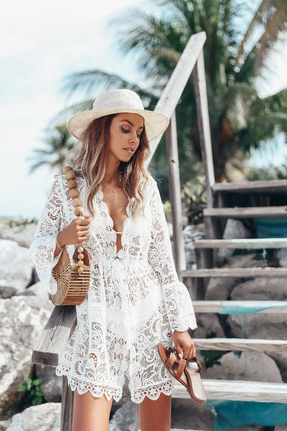 a delicate white lace mini beach dress with long bell sleeves is ideal for a boho beach look