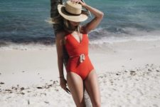 a red one piece swimsuit with a plunging neckline and a rope on the waist for a bold look
