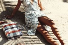 a striped midi wrap beach dress with short sleeves and a V-neckline is a perfect piece for relaxing
