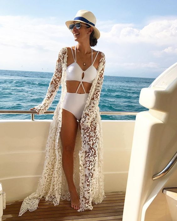 a white boho lace maxi coverup for a slight boho feel looks ethereal and airy