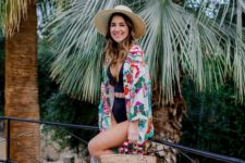 a white one piece swimsuit and a super colroful printed kimono for a contrast, a hat and a wicker bag