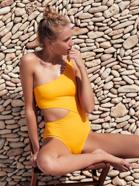 one shoulder sunny yellow swimsuit with a side cutout is a sexy and bright option