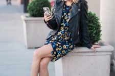 a dark floral mini dress, a black oversized leather jacket, white booties, a black bag for spring or fall