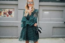 a green knee printed dress, white ankle boots, a two-tone bag for spring