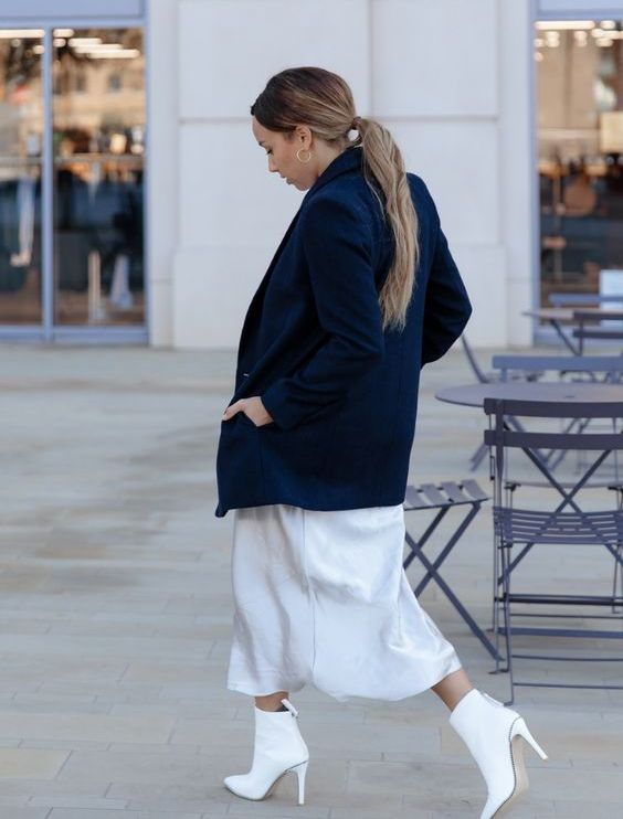 a white silk slip midi dress, a navy oversized blazer, white ankle booties for a statement spring look