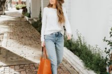 a white sweater, bleached skinnies with a raw hem, ocher booties and a cognac tote for a cold spring day