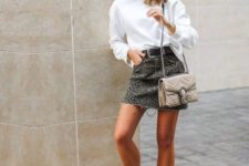 a white sweatshirt, a leopard print mini, white booties, a neutral bag for a trendy spring look