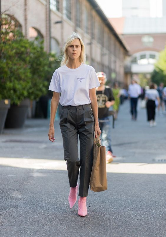 a white tee, grey pants, pink ankle boots, an ocher tote for a spring to summer outfit