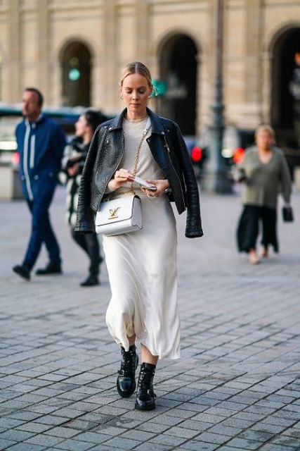 a white top, a layered flowy skirt, a black leather jacket, black lacquer boots and a white bag