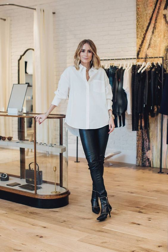 an oversized white shirt, black leather pants, black and white booties for a bold look