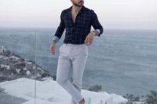 a black printed shirt, grey pants, white sneakers for an elegant summer look at work