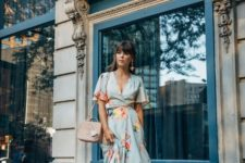 a blue floral wrap midi dress with short sleeves, yelloe platform shoes, a blush bag and statement earrings