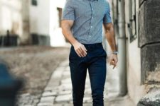 a blue plaid shirt with short sleeves, navy chinoes, white sneakers for a summer work look