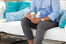 a blue shirt, grey cropped pants, neutral sneakers for an everyday summer work look